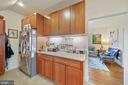 Modern kitchen has stainless steel appliances - 3249 38TH ST NW, WASHINGTON