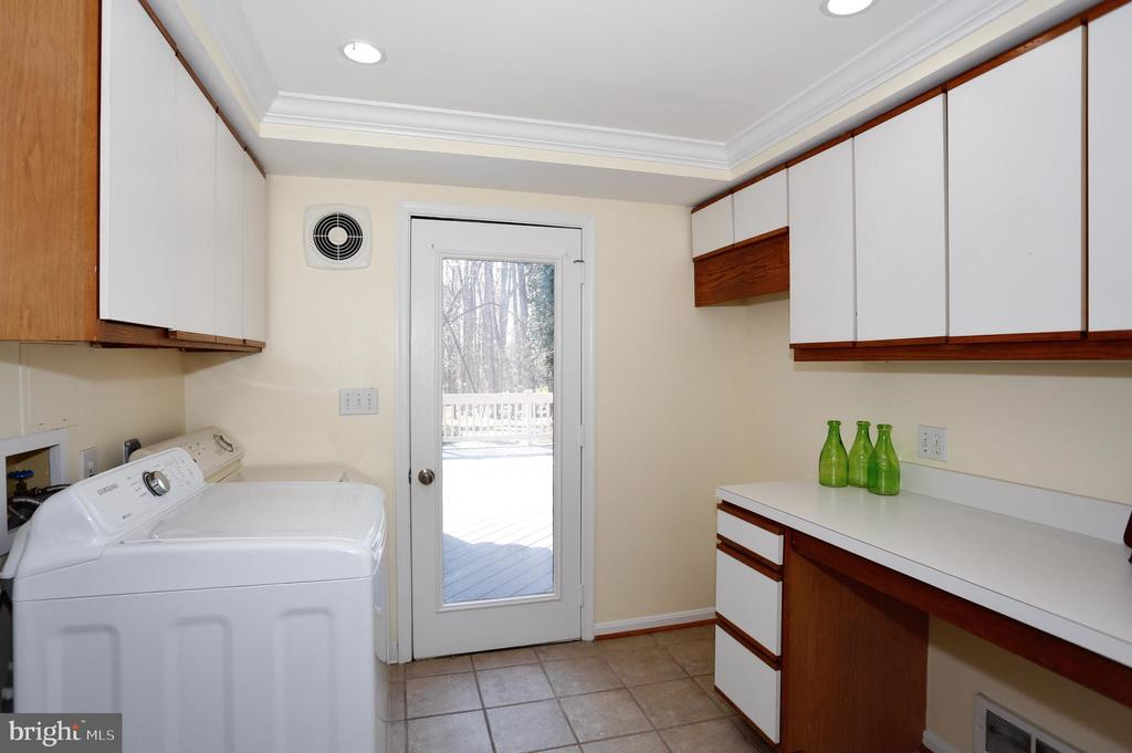 Laundry room and additional storage on main level - 14908 TALKING ROCK CT, NORTH POTOMAC