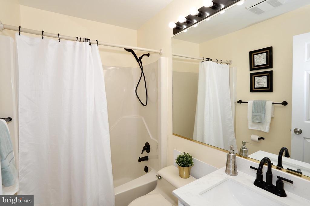 Main level hall bath (newly remodeled) - 14908 TALKING ROCK CT, NORTH POTOMAC