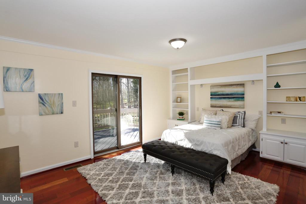 Master bedroom with walk-out onto deck - 14908 TALKING ROCK CT, NORTH POTOMAC