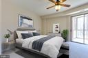 Virtually staged owners bedroom - 3100 N LEISURE WORLD BLVD #203, SILVER SPRING