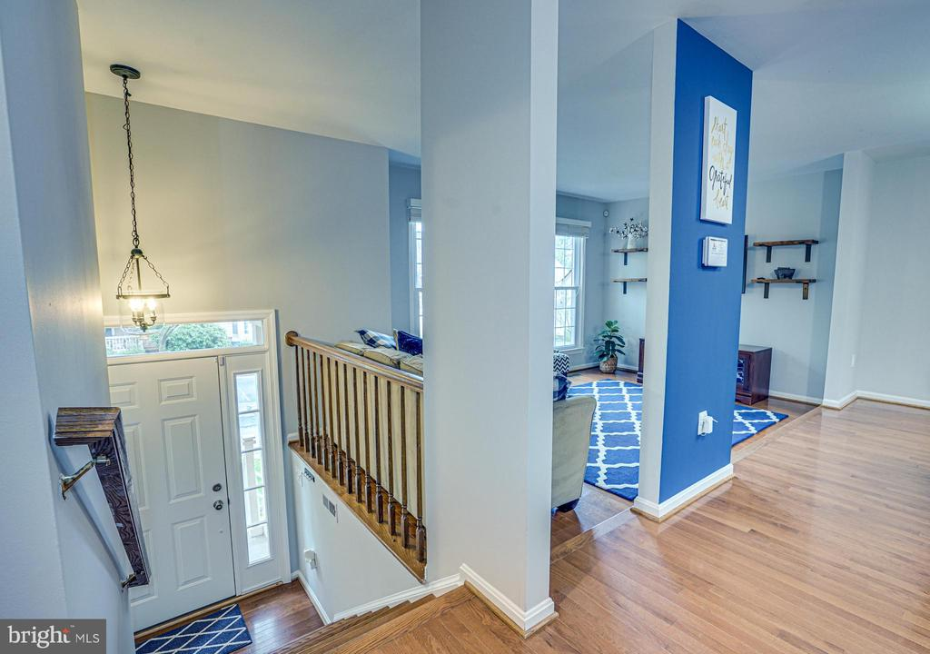 Entrance foyer coming up to landing - 11811 GREAT OWL CIR, RESTON