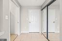 Foyer with large coat closet - 19375 CYPRESS RIDGE TER #516, LEESBURG