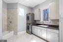 Main level mudroom/laundry room near garage entry - 658 LIVE OAK DR, MCLEAN