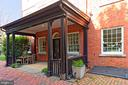 Covered porch with side entrance into the home - 711 PRINCE ST, ALEXANDRIA