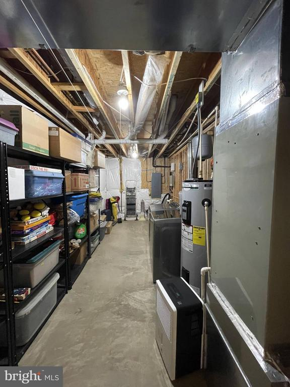 Lower Level Laundry and storage - 105 JEFFERSON AVE, LOCUST GROVE