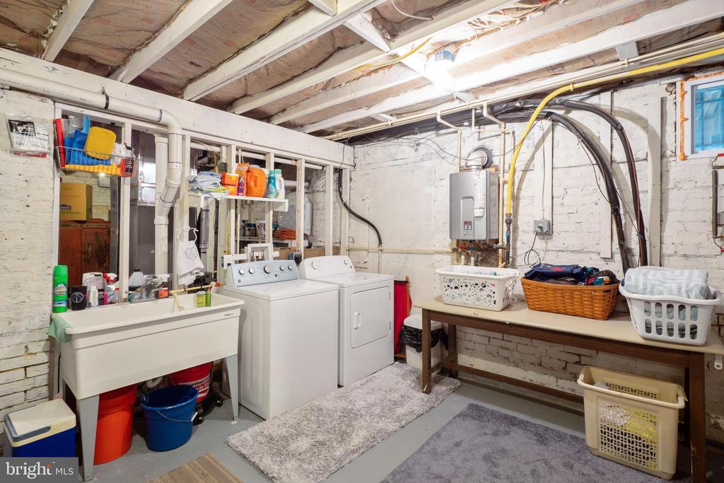 Large laundry area with door to rear patio - 1244 MONROE ST NE, WASHINGTON