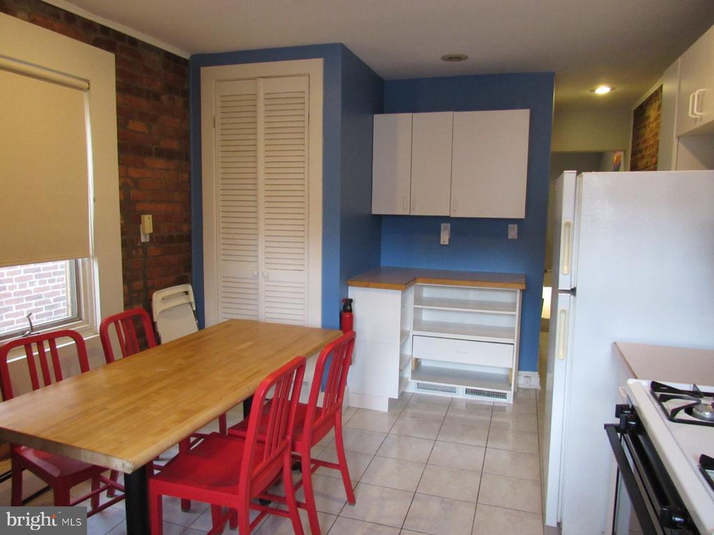 The second-floor kitchen offers plenty of storage - 1440 S ST NW, WASHINGTON