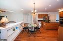 Breakfast area off Kitchen with shelves - 11413 RAMSBURG CT, NORTH POTOMAC