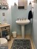 Convenient powder room off main level. - 4124 TROWBRIDGE ST, FAIRFAX
