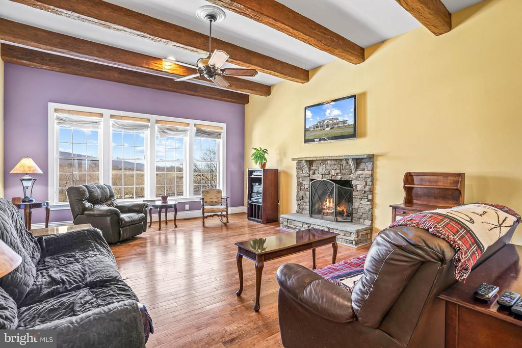 Wood Burning Stone Fireplace in Family Room - 11170 GEORGES MILL RD, LOVETTSVILLE