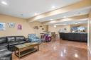 Amazing lower level rec area! Those epoxy floors!! - 43191 BURSTALL CT, LEESBURG