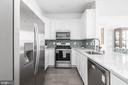 Remodeled kitchen has stainless steel appliance - 20261 MACGLASHAN TER, ASHBURN