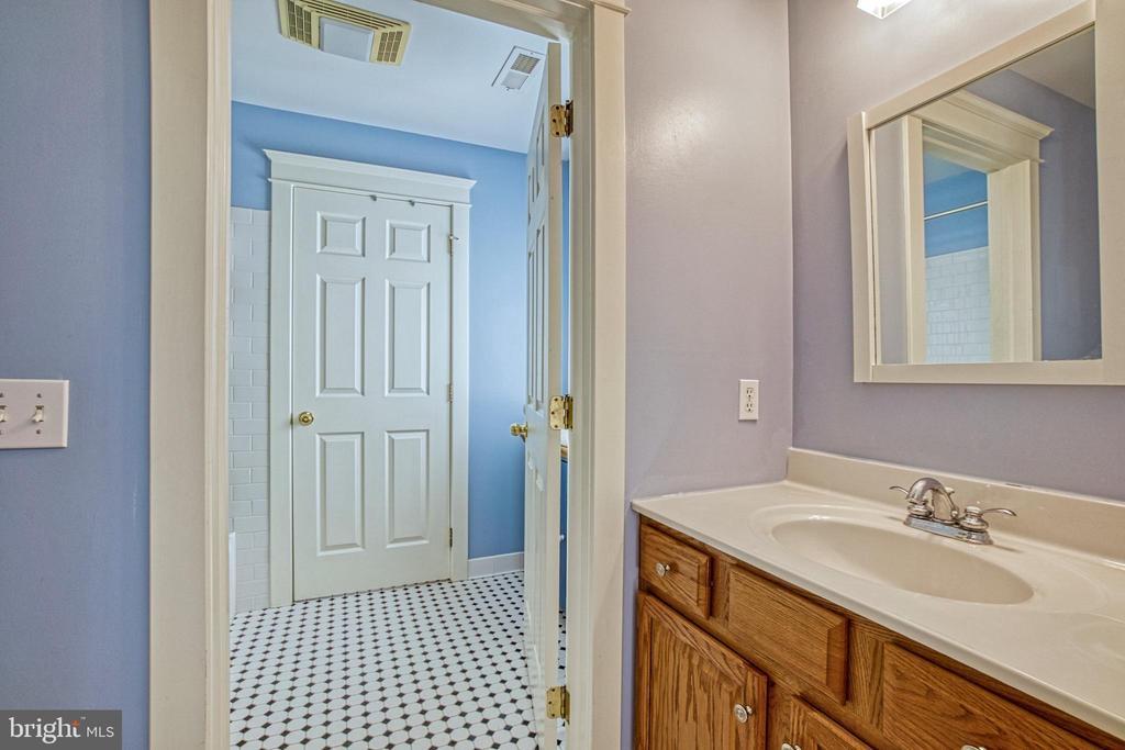 Jack-n-Jill bathroom. Powder room for BR #3. - 6519 ELMHIRST DR, FALLS CHURCH