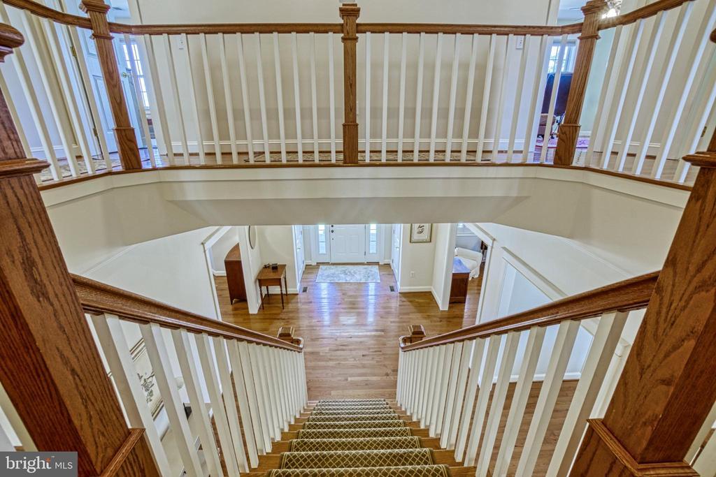 Split staircase. 2nd floor hallway. - 6519 ELMHIRST DR, FALLS CHURCH