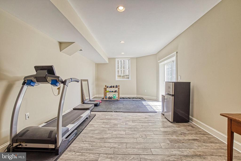 Bright Exercise area. French doors to back yard. - 6519 ELMHIRST DR, FALLS CHURCH