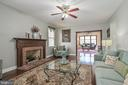 Welcoming family room has wood burning fireplace - 9326 MAINSAIL DR, BURKE