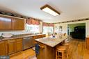 kitchen with large island - 35951 ASHBY FARM CIR, HILLSBORO