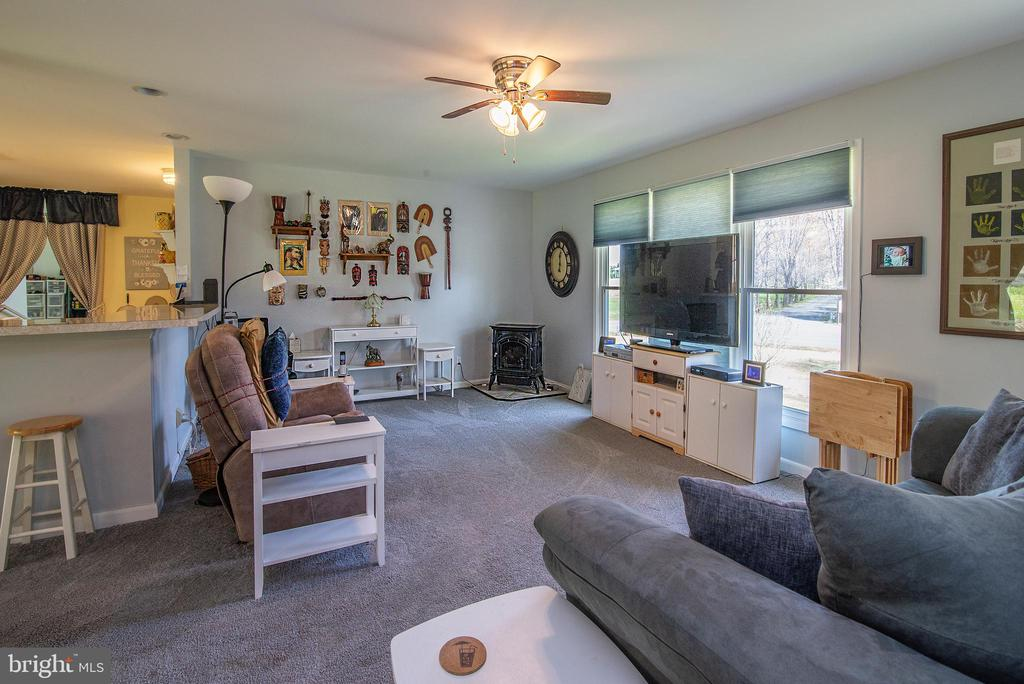 Large family room with stove. - 463 HARTWOOD RD, FREDERICKSBURG