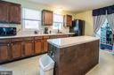 Kitchen island with windows over sink. - 463 HARTWOOD RD, FREDERICKSBURG