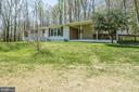 Front view of home with drive to carport and ramp - 463 HARTWOOD RD, FREDERICKSBURG