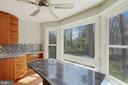 Custom granite table with waterfall conveys; - 11935 RIDERS LN, RESTON
