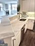 Kitchen View NEW GRANITE - 1641 INTERNATIONAL DR #104, MCLEAN