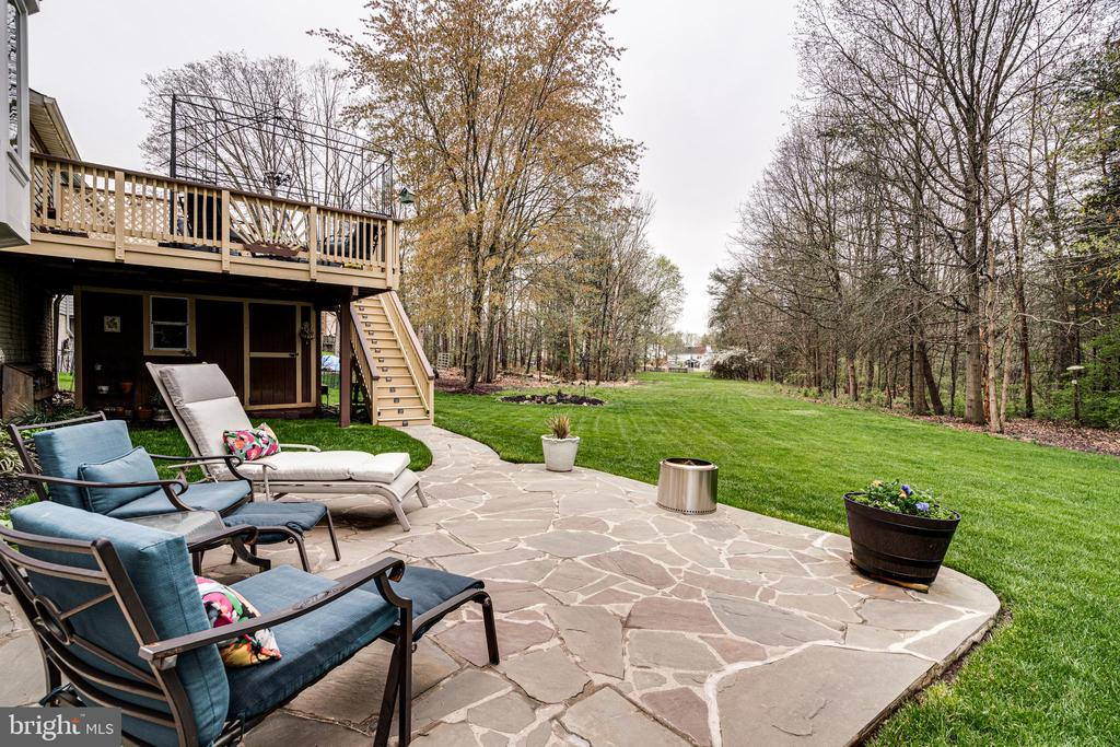 with a slate-stone patio - 14721 PICKETS POST RD, CENTREVILLE