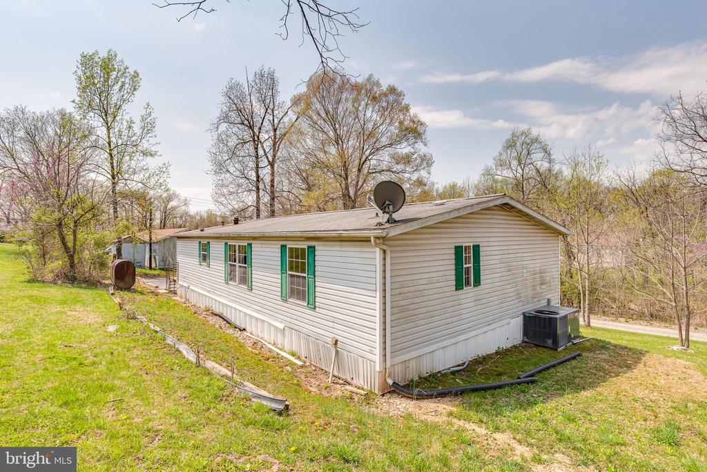 However, the sides and rear of the lot - 53 CAMP HILL LN, HARPERS FERRY
