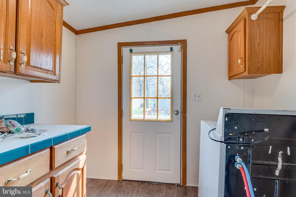 Cabinets provide storage, door to side of home - 53 CAMP HILL LN, HARPERS FERRY