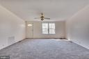 Living room is quite large, features bright window - 53 CAMP HILL LN, HARPERS FERRY