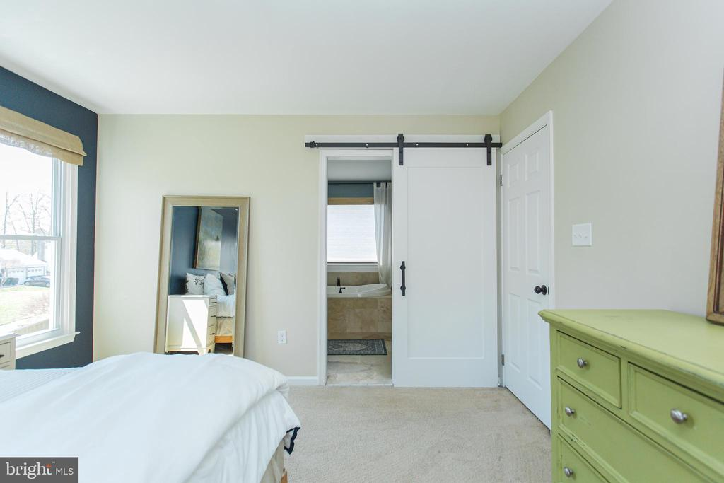 Barn door leads to your primary bath - 2 SNOW MEADOW LN, STAFFORD