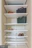 Second closet with shelving and shoe storage - 888 N QUINCY ST #802, ARLINGTON