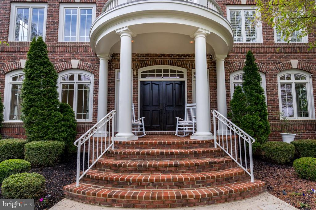 CLOSE UP OF CASCADING FRONT STEPS + COVERED PORCH - 23002 LOIS LN, BRAMBLETON