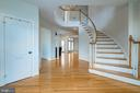 GRAND FOYER WITH CURVED STAIRCASE TO UPPER LEVEL - 23002 LOIS LN, BRAMBLETON