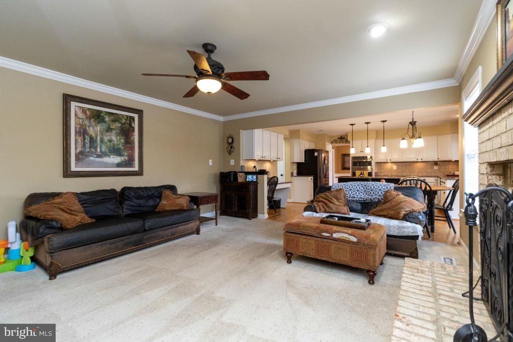 Spacious family room with wood burning fireplace - 706 RANDI DR SE, LEESBURG