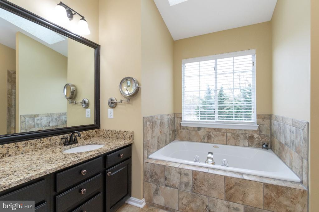 Updated bath #1 with granite counters - 706 RANDI DR SE, LEESBURG