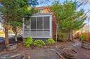 Semi-private yard with brick walls on two sides - 1033 N MONROE ST, ARLINGTON
