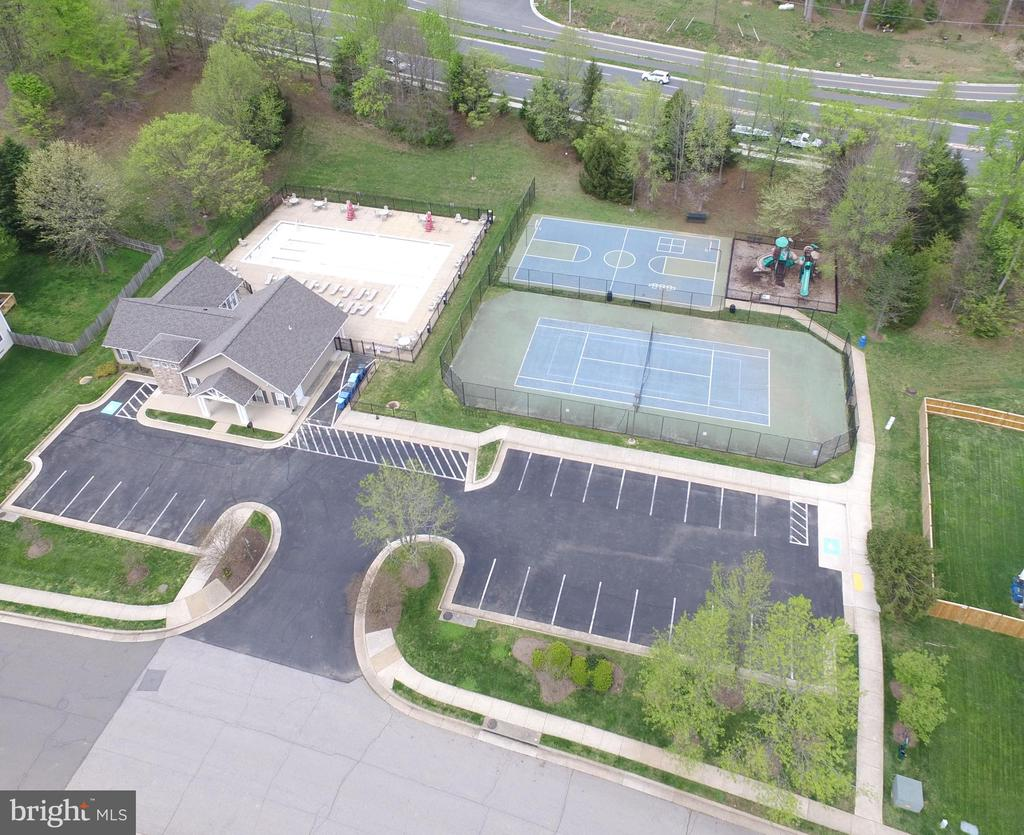 HOA clubhouse, Pool, Tennis courts, and playground - 14917 GLADIOLUS CT, WOODBRIDGE