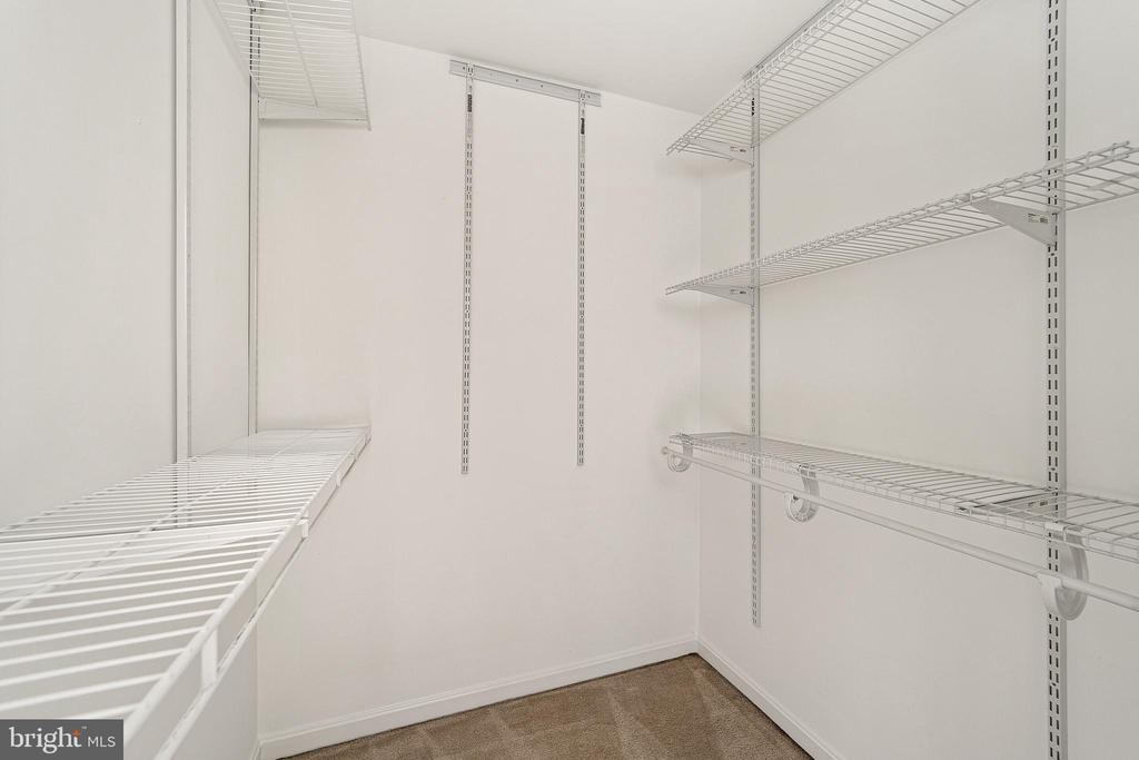 Primary suite closet - 43490 MINK MEADOWS ST, CHANTILLY