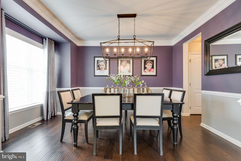 Formal Dining Room with Crown & Chair Moldings - 24215 CRABTREE CT, ALDIE