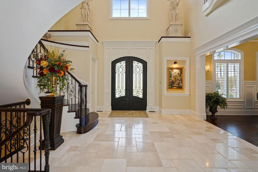 Two Story Foyer with Wood and Iron Gate Front Door - 22608 CREIGHTON FARMS DR, LEESBURG