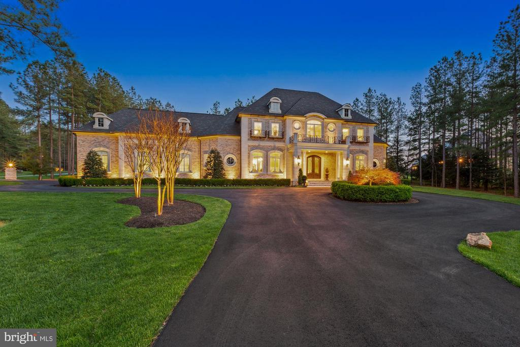 French Manor Estate Accented by Dramatic Lighting - 22608 CREIGHTON FARMS DR, LEESBURG