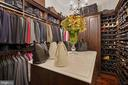 Owner's Closet with Built-in Island and Dresser - 22608 CREIGHTON FARMS DR, LEESBURG