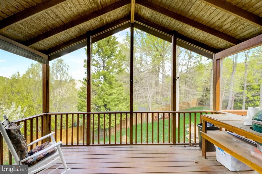 Enjoy the outdoors from the screen-in porch. - 8900 MAGNOLIA RIDGE RD, FAIRFAX STATION