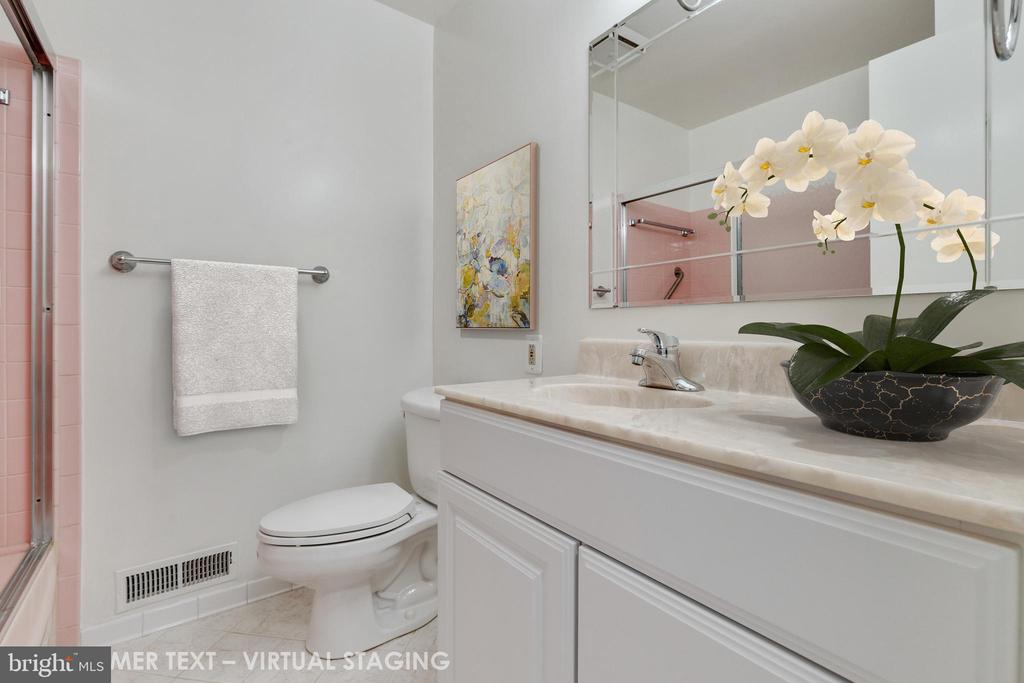 Hall bathroom with updated vanity - 5041 KING RICHARD DR, ANNANDALE
