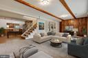Lower level family room with built-in shelving - 5041 KING RICHARD DR, ANNANDALE