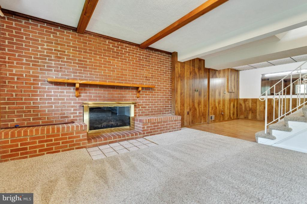 Brick hearth with gas log inserts - 5041 KING RICHARD DR, ANNANDALE