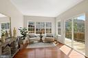 Brilliant and bright sunroom off of kitchen - 25532 GOVER DR, CHANTILLY