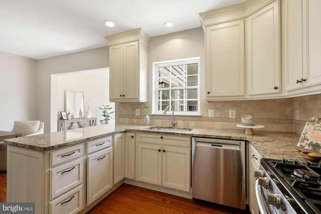 Recessed lighting in the gourmet kitchen - 25532 GOVER DR, CHANTILLY